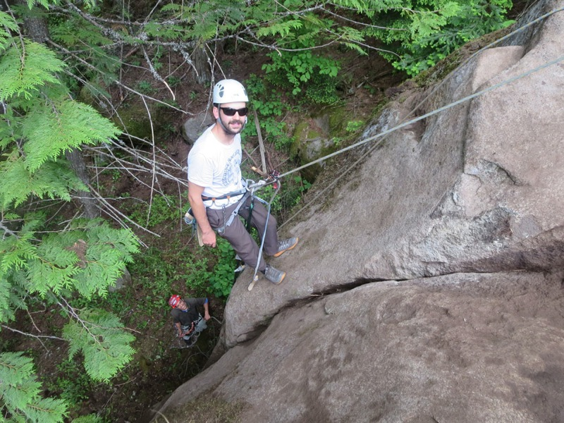 One man works hard building a rock climbing route in Ymir, British Columbia